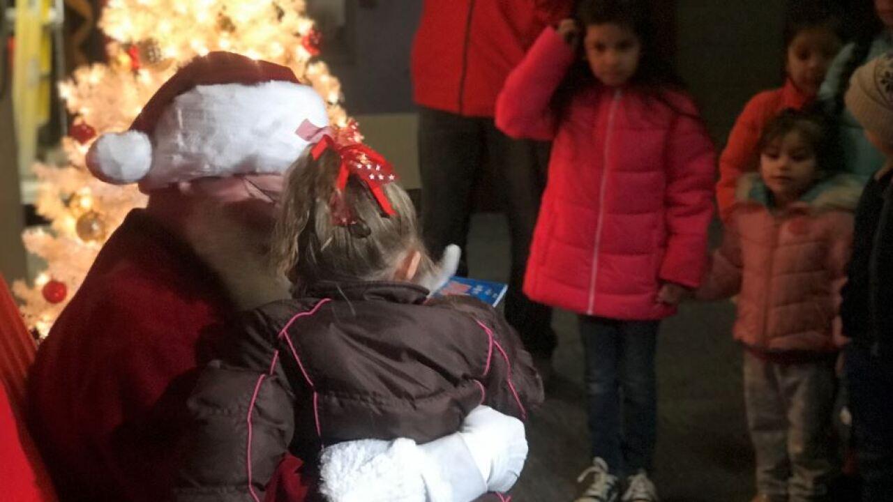 Santa visits dozens of children at KCPD's East Patrol.