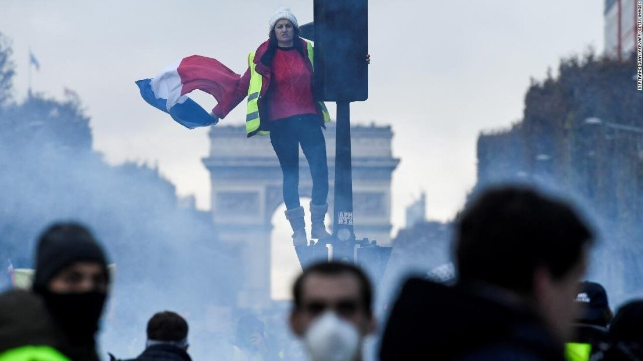 Police make dozens of arrests and fire tear gas at Paris fuel protesters
