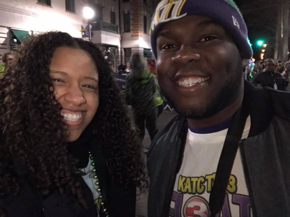 KATC's Eman Boyd and Seth Lewis walking the parade route as Float Finders