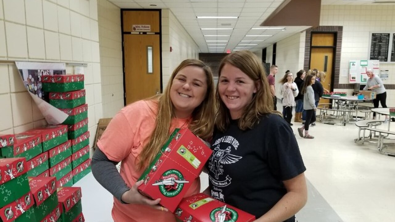 Abby's Angels pack 130 boxes for less fortunate