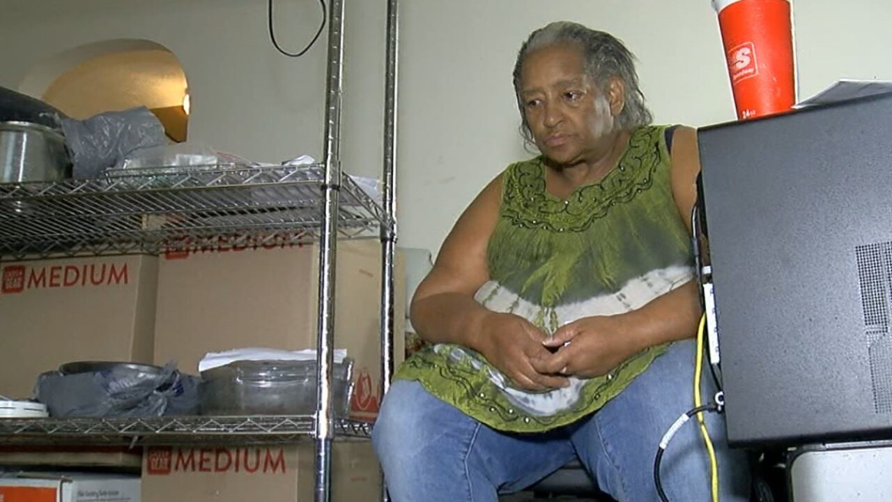 Valerie Lane sits in her Westwood apartment, surrounded by possessions she is trying to keep dry.