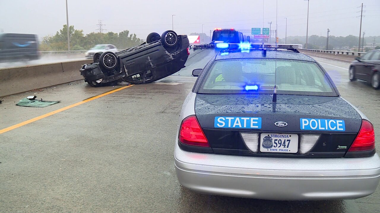 One hospitalized, charged after flipping vehicle on I-195