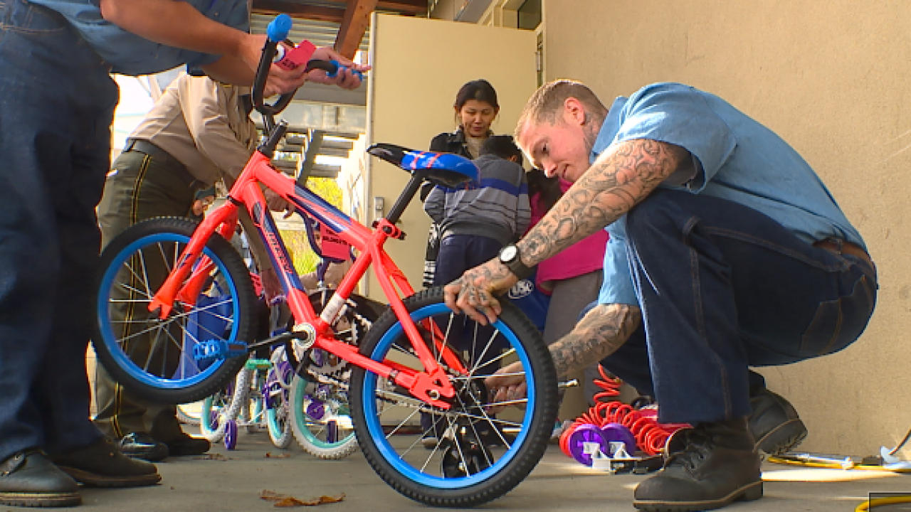inmates deliver bikes to kids san diego