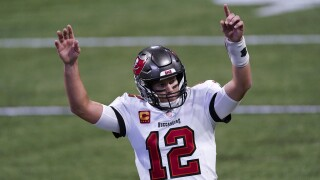 Tampa Bay Buccaneers QB Tom Brady reacts after TD vs. Atlanta Falcons in December 2020