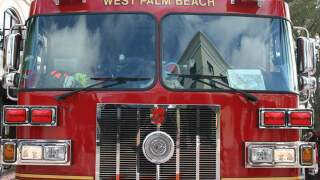 Firefighters and police investigate targeted explosion at West Palm Beach apartments