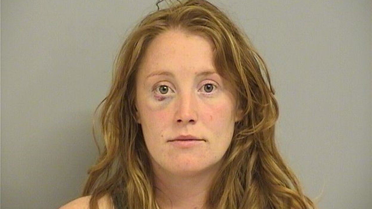 Woman arrested after hitting two people with car outside roller rink