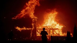 Thousands flee fast moving wildfire in Northern California