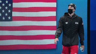Abrahamson: Black cap in hand, USA swimmer Mitchell takes last place win