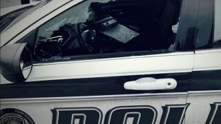 The Great Falls Police Department is asking for help in identifying and locating the person or people responsible for breaking the window of a patrol car.