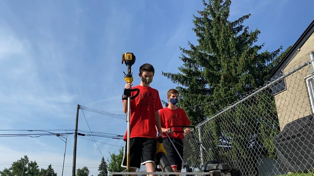 Michigan brothers complete viral challenge, help their community by mowing lawns for free