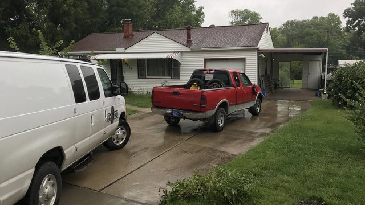 Homeowner finds strange red pickup in driveway