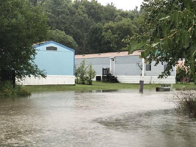 PHOTOS: Storms bring wind, record rains, flooding