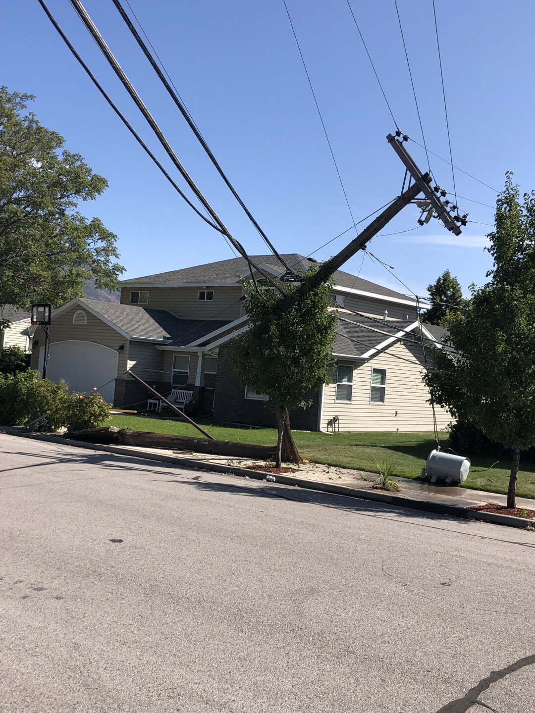 Photos: Dump truck damages 10 power poles in Provo neighborhood