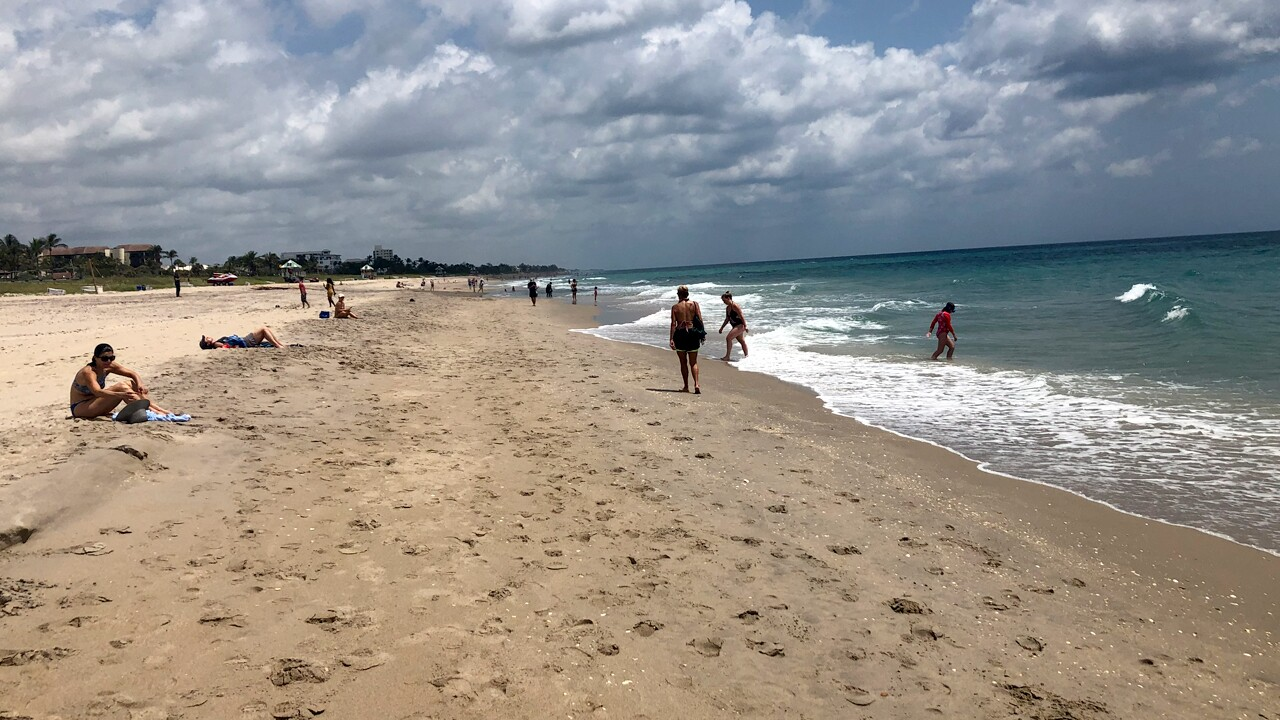 Beachgoers in Delray Beach on May 19, 2020 for a dip in the ocean or a stroll on the sand.