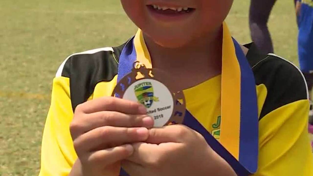 Does every child deserve a trophy or participation medal?