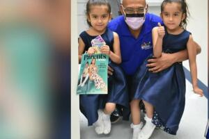 Once conjoined, twins now living life to fullest