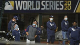 Few fans, masked umps, muted celebrations for World Series