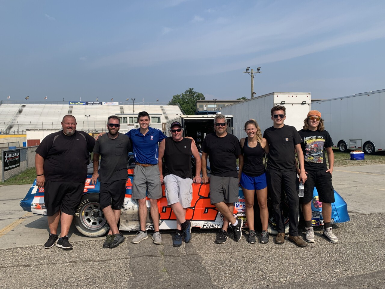 Harig poses with those helping at Berlin Raceway