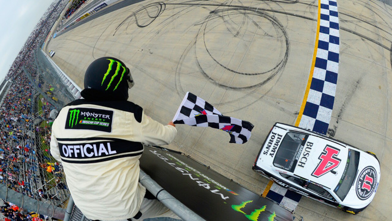 Kevin Harvick takes the checkered flag at Dover for 4th win