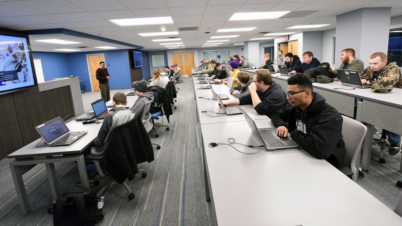 Professor Stanley Smith leads a class in the R.C. Musson and Katherine M. Musson Charitable Foundation ICS Testbed, where UA students have access to state-of-the-art equipment.