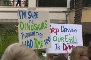 WPTV-CLIMATE-PROTEST-SIGNS.jpg