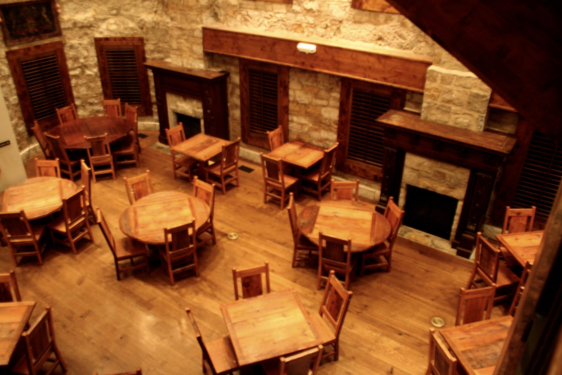 Castle Caenen Seating Main Floor with Reclaimed Barn Wood Tables and Chairs.jpg