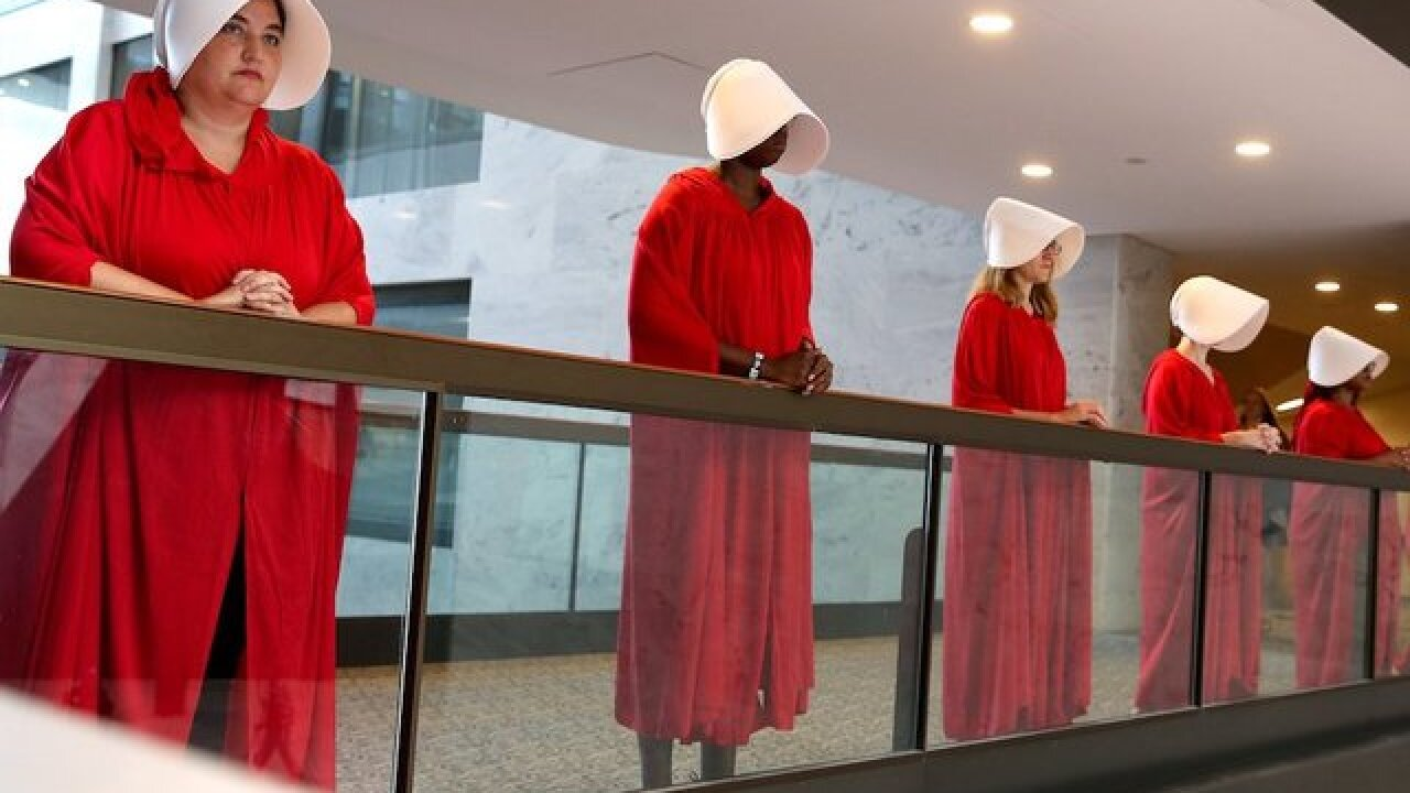 Silent protesters dressed as 'handmaids' have a very loud message: Stop Kavanaugh