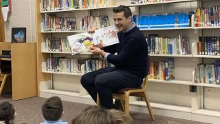 Brad Galli reads at St. Hugo during March is Reading Month