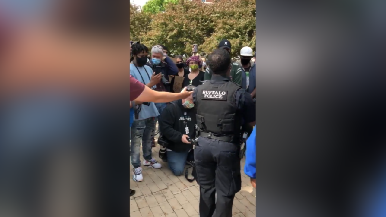 Buffalo police officer leads protesters in 'We Shall Overcome' hymn