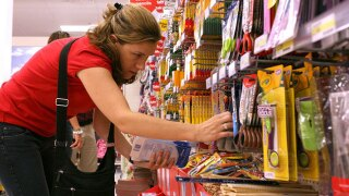 woman buying school supplies