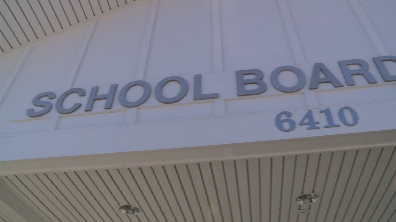 Sources: Convicted felon worked at school board office in CentralVa.