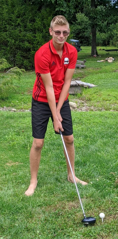 Carson practices golf.