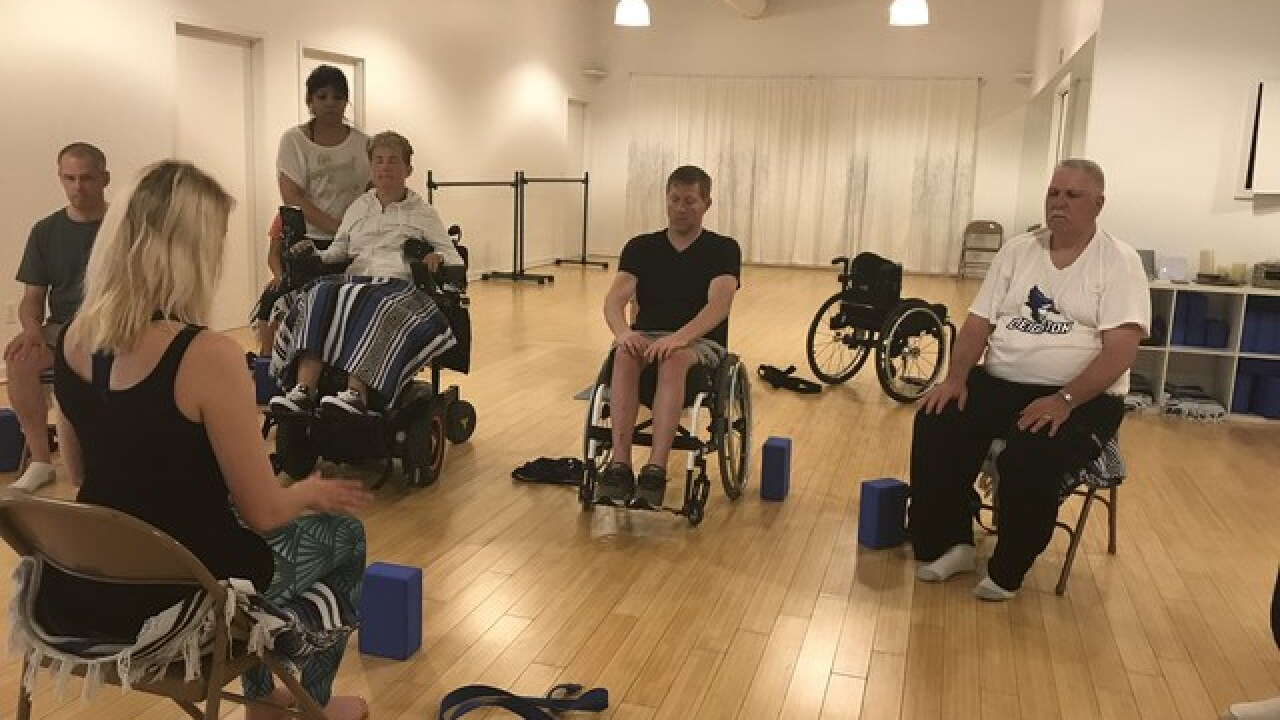 Omaha studio offers yoga to paraplegic patients