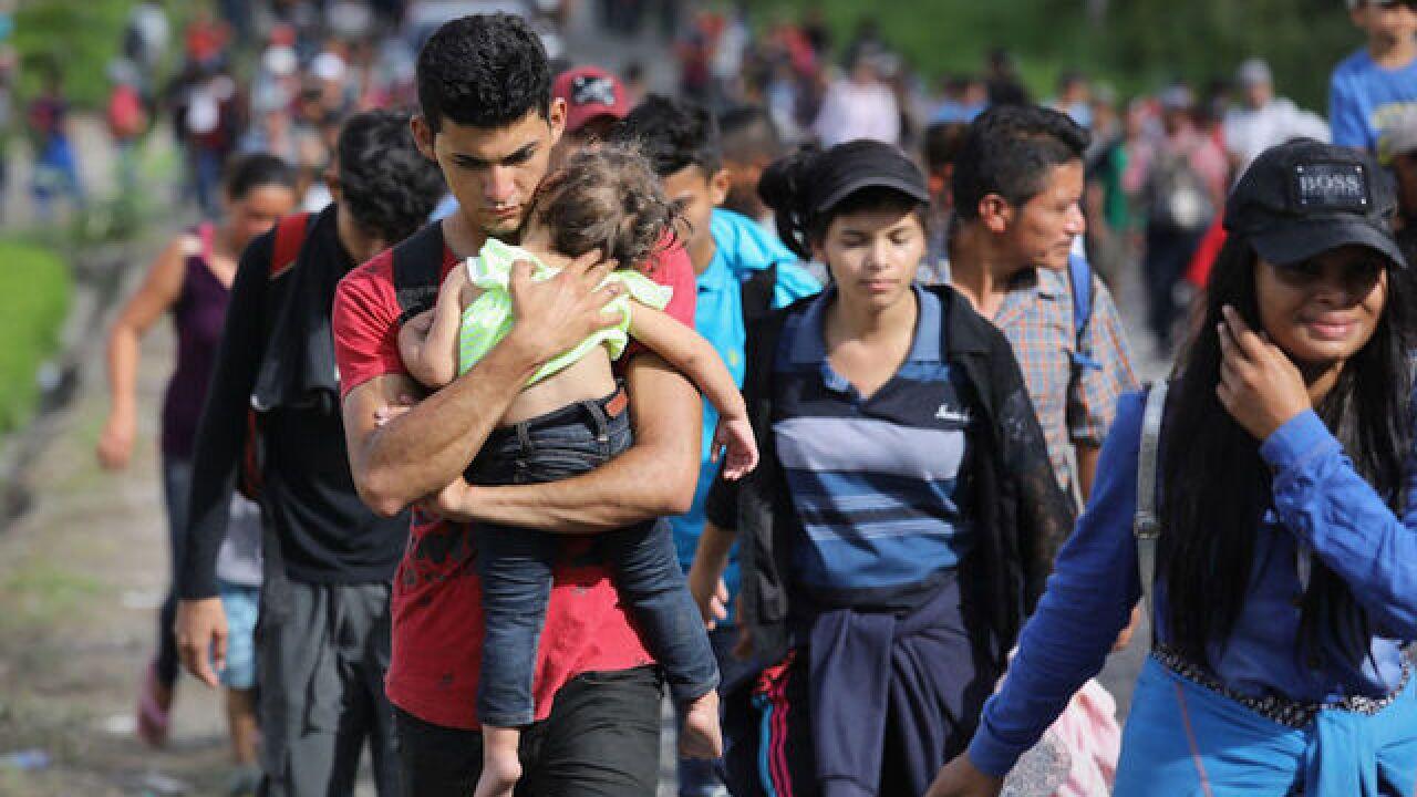 Migrant caravan grows before push into Mexico