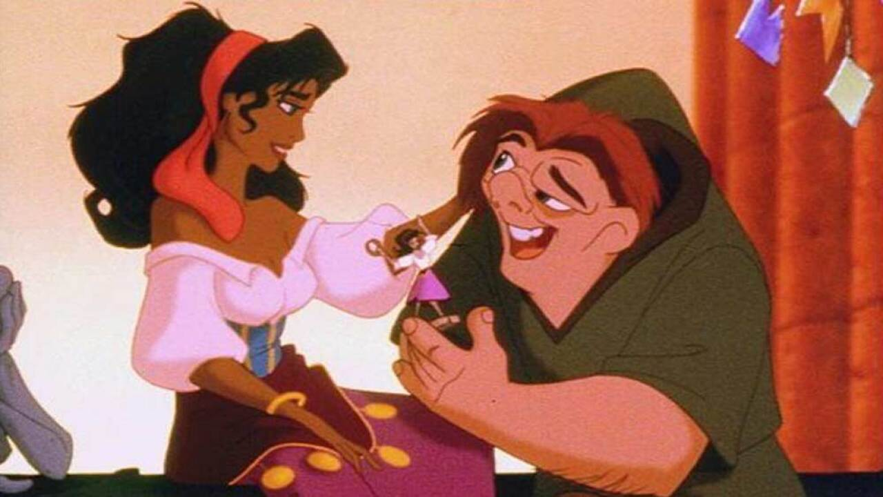 """Esmeralda and Quasimodo in scene from Disney movie """"The Hunchback Of Notre Dame"""""""