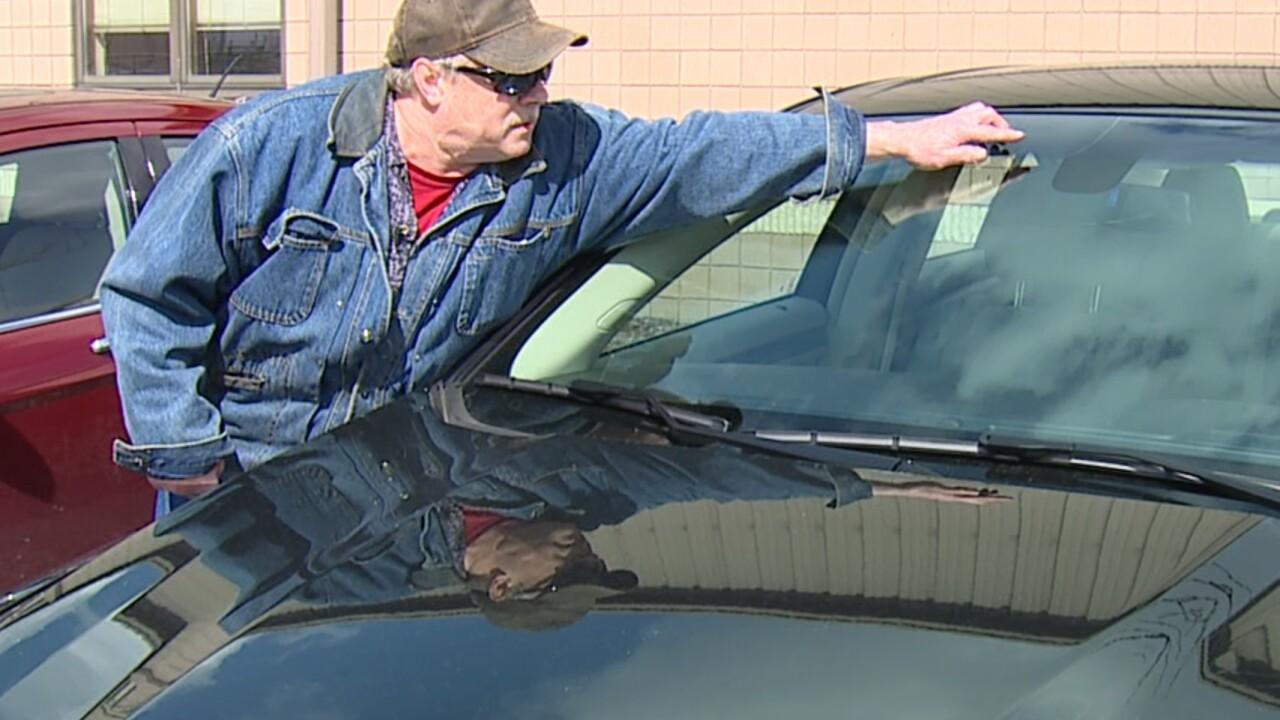 Matt Jeske points to windshield damage