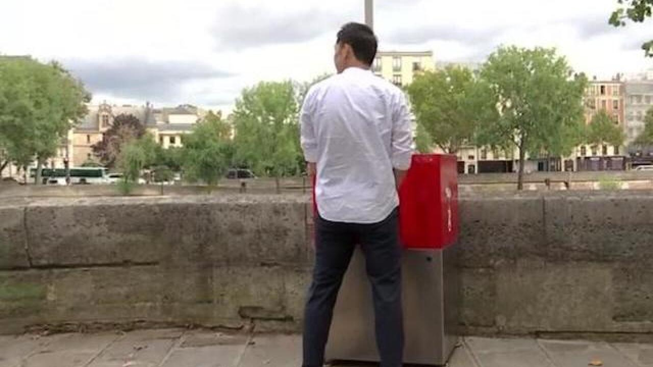 Eco-friendly open air urinals cause uproar in Paris