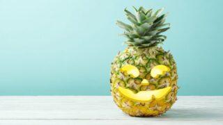 Give Halloween A Tropical Twist With Pineapple Jack-o-lanterns