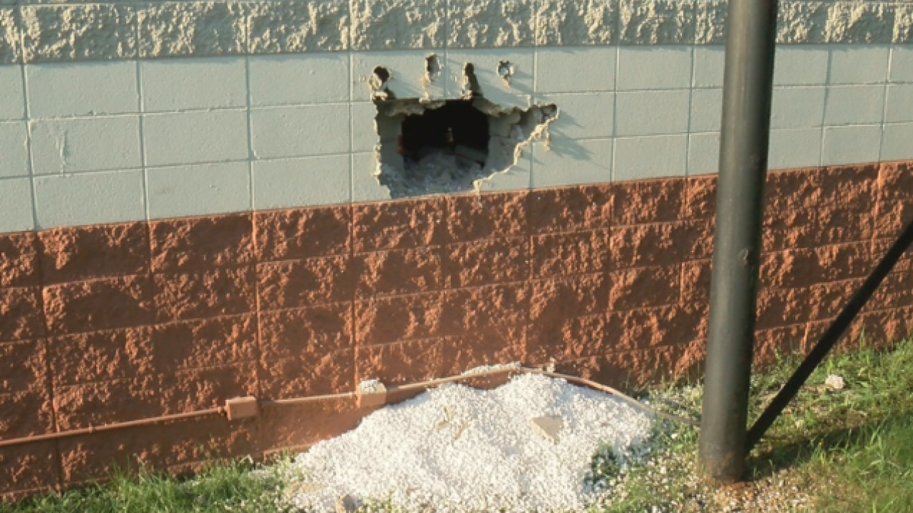 Burglers punch hole through wall of Best Buy