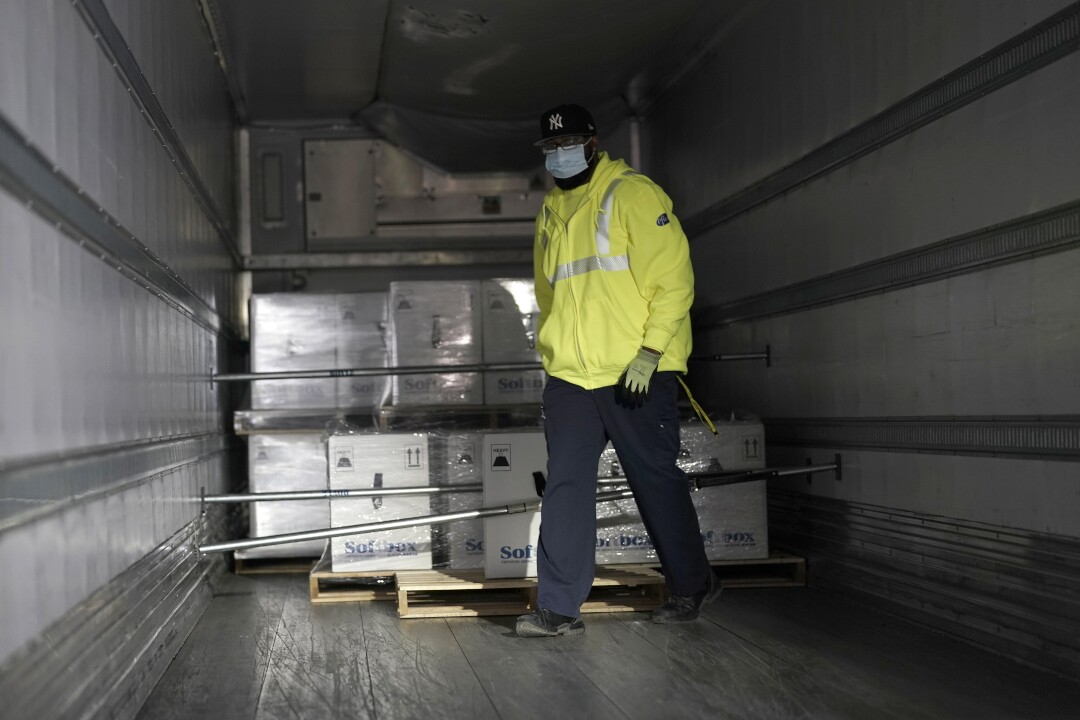 Pfizer Portage plant COVID-19 vaccine shipping worker loads pallets with boxes into truck December 13, 2020