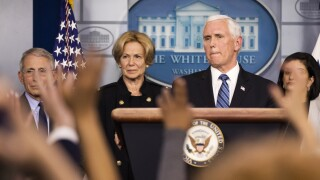 Member of Pence's staff tests positive for virus