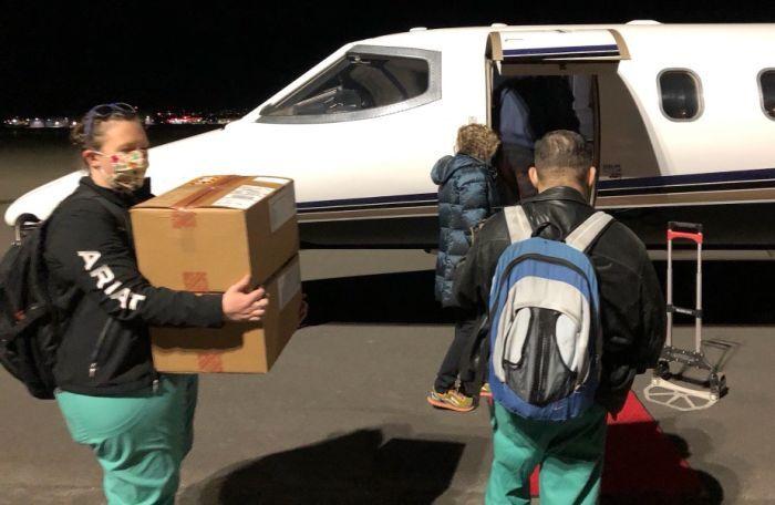 MTVAHCS staff loading the plane