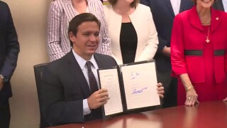Florida Gov. Ron DeSantis signs HB 3 into law at Indian River State College in Fort Pierce on July 22, 2021.jpg