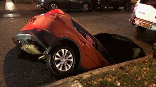 car sinkhole queens