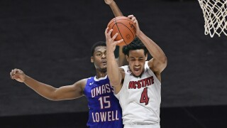 NC State Wolfpack Jericole Hellems pulls down rebound vs. UMass Lowell in 2020