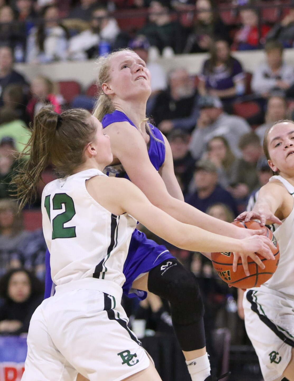 Sadie Filius is fouled as she attempts a shot.jpg