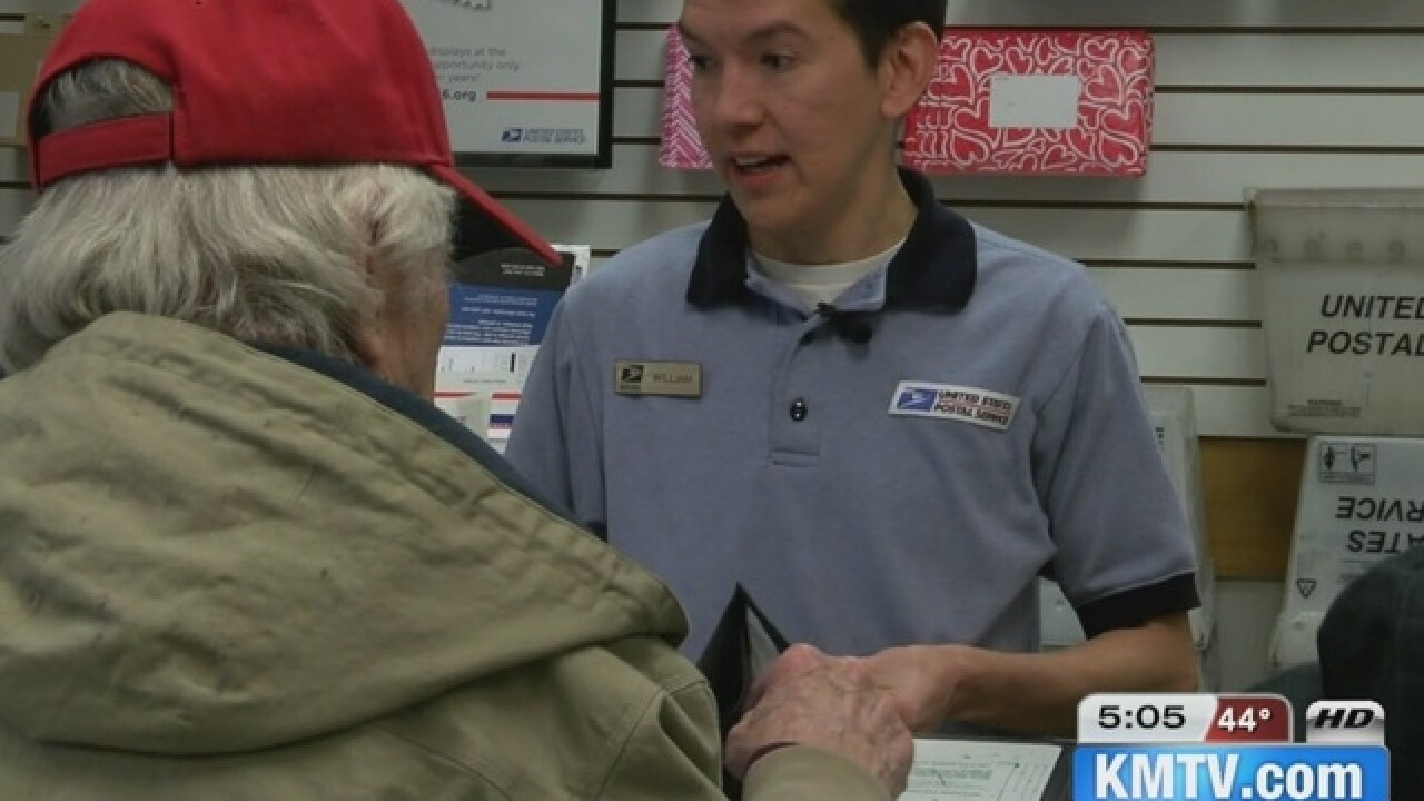 Postal worker helps stop woman from being...