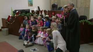 Boy brings whole class to county's Adoption Day