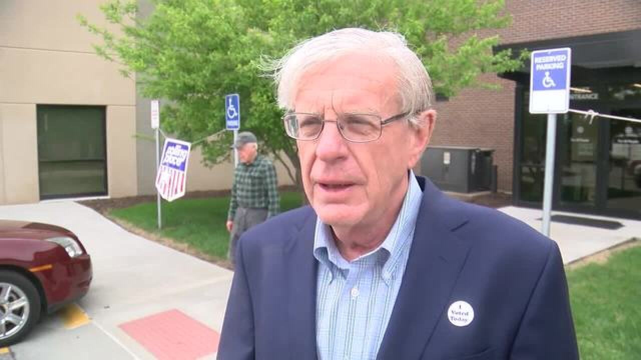 Brad Ashford votes in Democratic primary