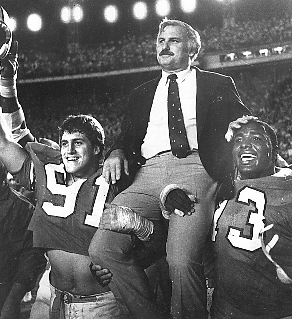Miami Hurricanes head coach Howard Schnellenberger carried off field after winning 1984 Orange Bowl